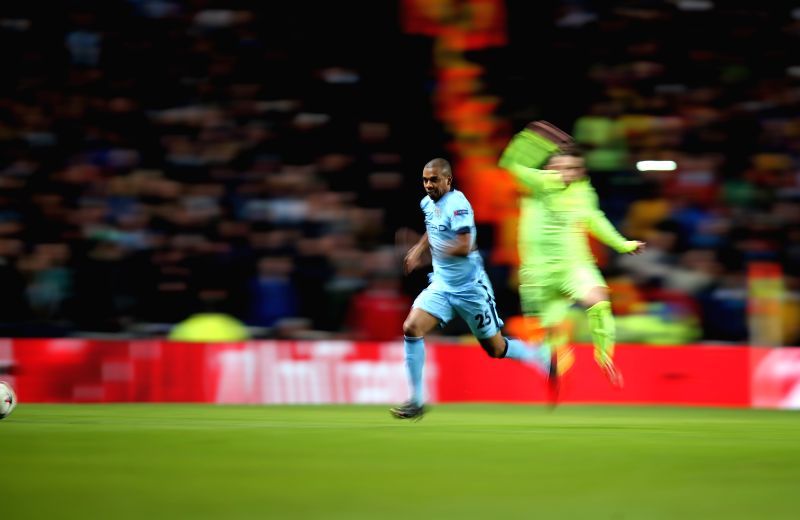 Fernandinho (L) of Manchester city breaks through during the UEFA Champions League Round of 16 first leg match between Manchester City and Barcelona at Etihad ...