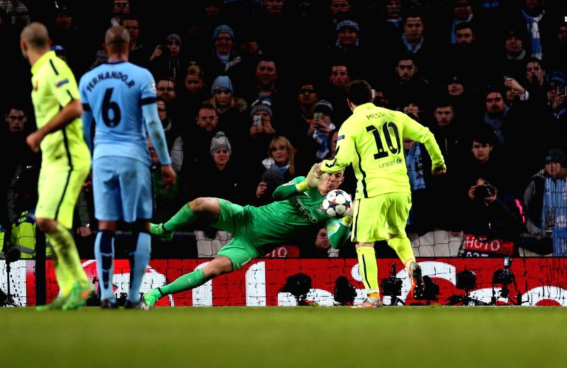 Joe Hart (2nd R), goalie of Manchester city, makes a penalty save of Lionel Messi of Barcelona during the UEFA Champions League Round of 16 first leg match ...
