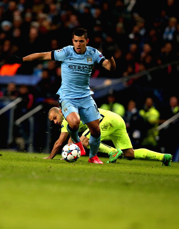 Sergio Aguero (front) of Manchester City breaks through during the UEFA Champions League Round of 16 first leg match between Manchester City and Barcelona at ...