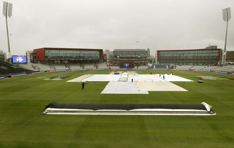 Manchester: Groundsmen cover the pitch at Old Trafford in Manchester, England on June 15, 2019. (Photo: Surjeet Yadav/IANS)