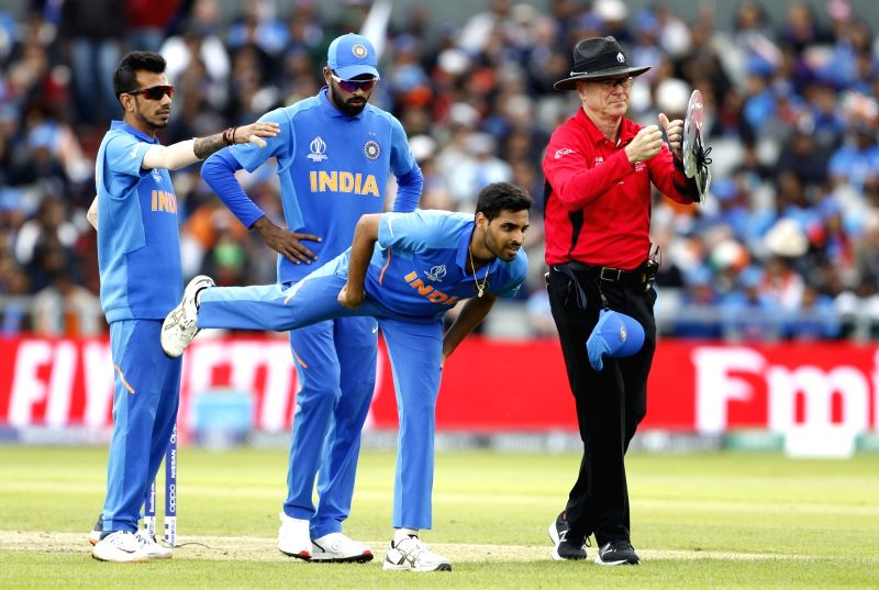 Manchester: India's Bhuvneshwar Kumar stretching his hamstring after suffering a hamstring niggle while bowling during the 22nd match of 2019 World Cup between India and Pakistan at Old Trafford in Manchester, England on June 16, 2019. (Photo: Surjee