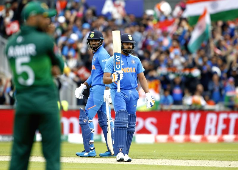 Manchester: India's Rohit Sharma celebrates his half century during the 22nd match of 2019 World Cup between India and Pakistan at Old Trafford in Manchester, England on June 16, 2019. (Photo: Surjeet Yadav/IANS)