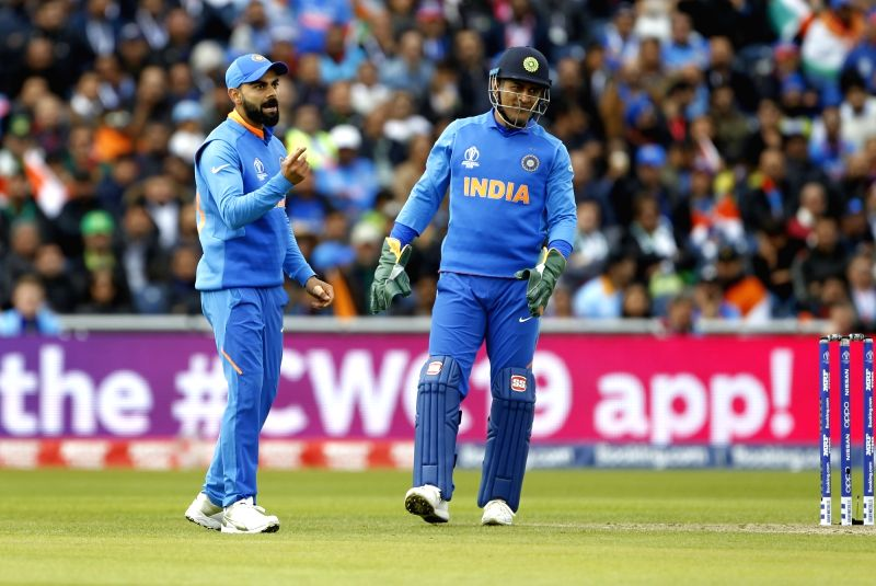 Manchester: Indian skipper Virat Kohli and MS Dhoni during the 22nd match of 2019 World Cup between India and Pakistan at Old Trafford in Manchester, England on June 16, 2019. (Photo: Surjeet Yadav/IANS)