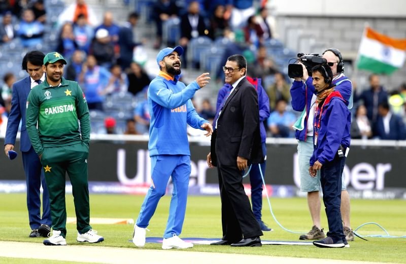 Manchester: Indian skipper Virat Kohli and Pakistani skipper Sarfaraz Ahmed during the toss ahead of the 22nd match of 2019 World Cup between India and Pakistan at Old Trafford in Manchester, England on June 16, 2019. Pakistan won the toss and electe