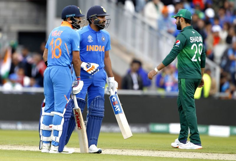 Manchester: Indian skipper Virat Kohli and Rohit Sharma during the 22nd match of 2019 World Cup between India and Pakistan at Old Trafford in Manchester, England on June 16, 2019. (Photo: Surjeet Yadav/IANS)
