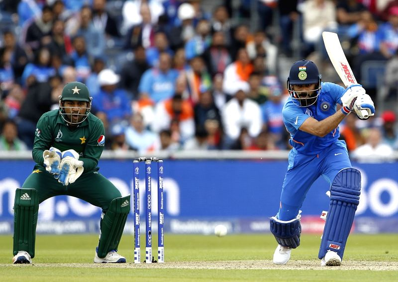 Manchester: Indian skipper Virat Kohli in action during the 22nd match of 2019 World Cup between India and Pakistan at Old Trafford in Manchester, England on June 16, 2019. Also seen Pakistani skipper Sarfaraz Ahmed. (Photo: Surjeet Yadav/IANS)