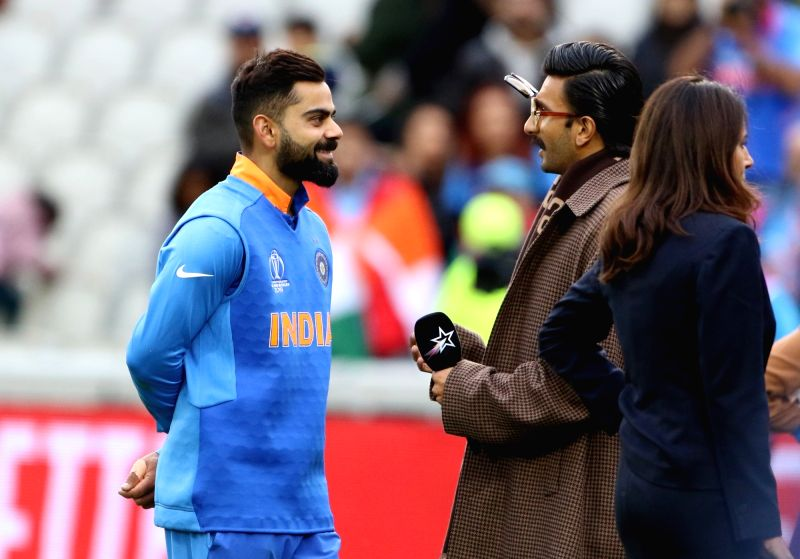 Indian skipper Virat Kohli interacts with actor Ranveer Singh after winning the 22nd match of 2019 World Cup between against Pakistan at Old Trafford in Manchester