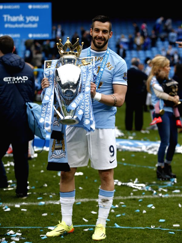 Alvaro Negredo of Manchester City poses with the Premier League trophy at the end of the Barclays Premier League match between Manchester City and West Ham United
