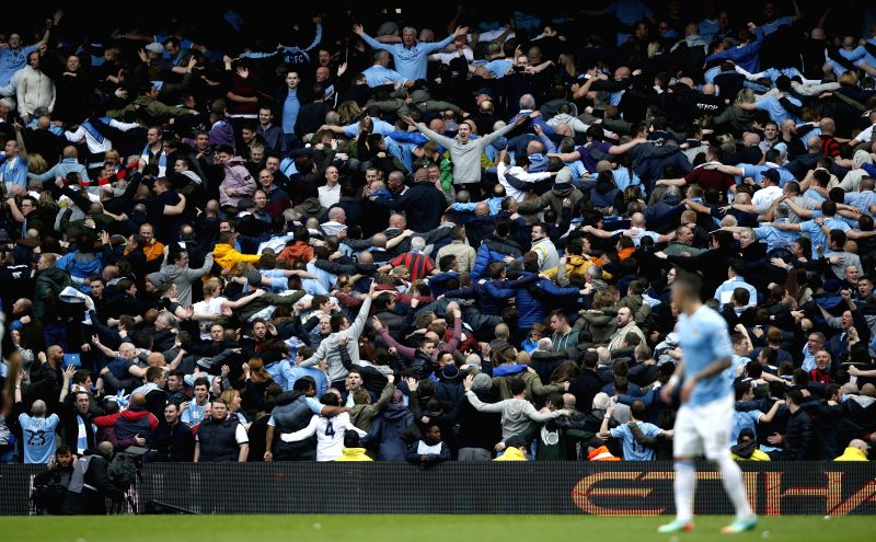 Manchester City fans perform the Poznan Celebration during the Barclays Premier League match between Manchester City and West Ham United at Etihad Stadium in ...