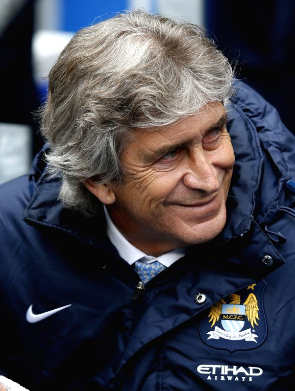 The Manchester City Manager Manuel Pellegrini looks on ahead of the Barclays Premier League match between Manchester City and West Ham United at Etihad Stadium in
