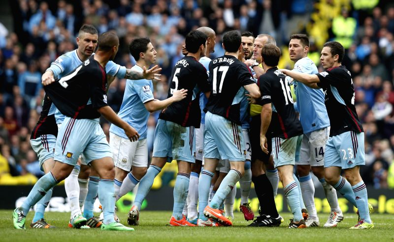 The West Ham and Manchester City players scuffle as Mark Noble of West Ham United clashes with Sergio Aguero of Manchester City during the Barclays Premier League