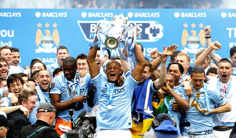 Vincent Kompany (C) of Manchester City lifts the Premier League trophy at the end of the Barclays Premier League match between Manchester City and West Ham United