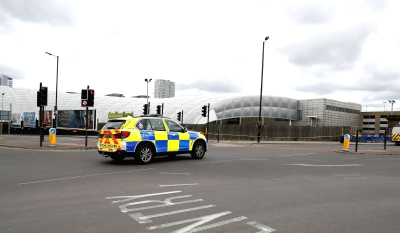 MANCHESTER, May 23, 2017 - A police car partrols near the Manchester Arena in Manchester, Britain, May 23, 2017. A total of 22 people, including children, were killed and 59 others injured in a ...
