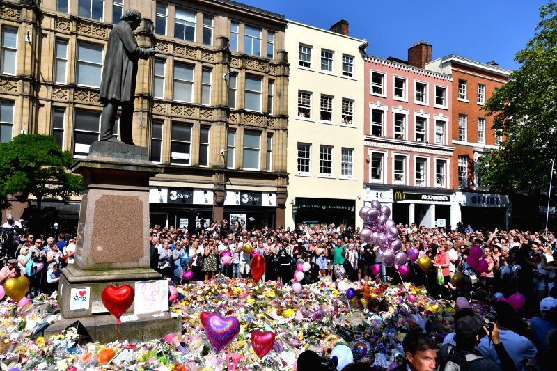 MANCHESTER, May 25, 2017 - People observe a minute's silence to honor the victims of the Manchester Arena attack at St. Anne's Square in Manchester, Britain, May 25, 2017.