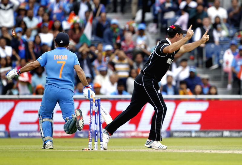 Manchester: New Zealand's Martin Guptill celebrates the dismissal of M.S. Dhoni with teammates during the 1st Semi-final match of 2019 World Cup between India and New Zealand at Old Trafford in Manchester, England on July 10, 2019. (Photo: Surjeet Ku