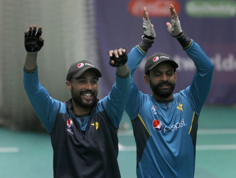 Manchester: Pakistan's Mohammad Amir and Mohammad Hafeez during practice session at Old Trafford ahead of World Cup 2019 match against India in Manchester, England on June 15, 2019. (Photo: Surjeet Yadav/IANS)