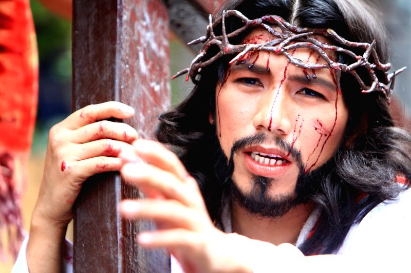 An actor portrays the role of Jesus Christ during a Passion Play on a street in Mandaluyong City, the Philippines, April 17, 2014. The Passion Play is a ..