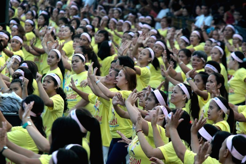 "Women exercise during the ""All-Women Aerodance"" in Mandaluyong City, the Philippines, March 15, 2015. More than 26,000 women participated in the ..."