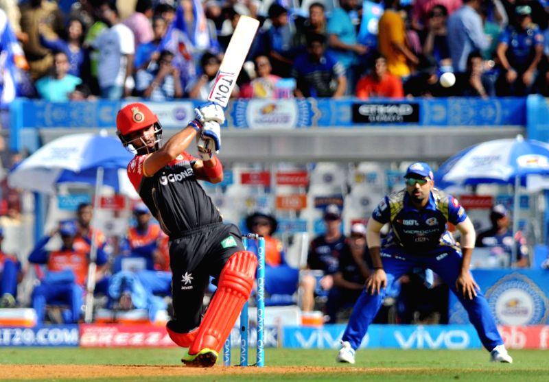 Mandeep Singh of Royal Challengers Bangalore plays a shot during an IPL 2017 match between Mumbai Indians and Royal Challengers Bangalore at at Wankhede Stadium in Mumbai on May 1, 2017. - Mandeep Singh
