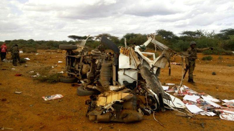 MANDERA (KENYA), May 25, 2017 Phone photo provided by Kenya Police Service shows a damaged vehicle at the site of a roadside blast in Mandera, Kenya, May 24, 2017. At least five security ...