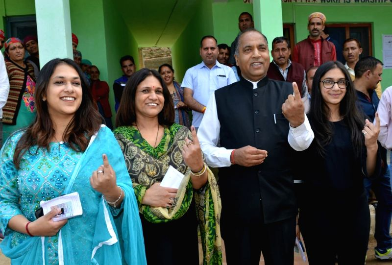 Mandi: Himachal Pradesh Chief Minister Jairam Thakur shows his forefinger marked with indelible ink after casting vote during the seventh and the last phase of 2019 Lok Sabha Elections at a polling booth in Mandi on May 19, 2019. Also seen his wife a