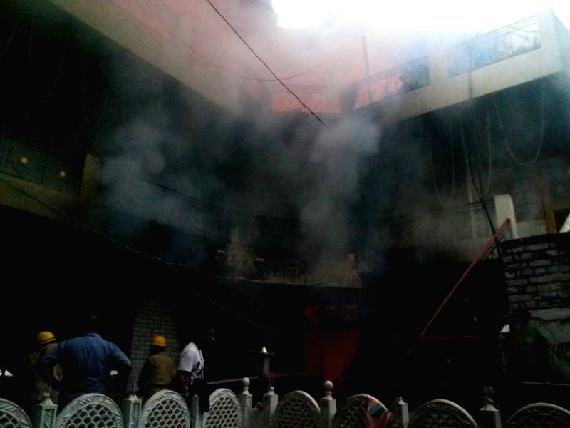 :Mandi: Smoke comes out from the Ner Chowk house that caught fire, in Himachal Pradesh's Mandi on July 23, 2018. At least five persons, including three women, of a wedding party were charred ...
