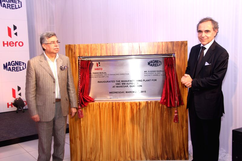 Hero MotoCorp Ltd. Vice Chairman, MD and CEO Pawan Munjal and Magneti Marelli, CEO Eugenio Razelli during the inauguration of HMC-MM Auto Ltd`s first autonomous `Production and Development ...