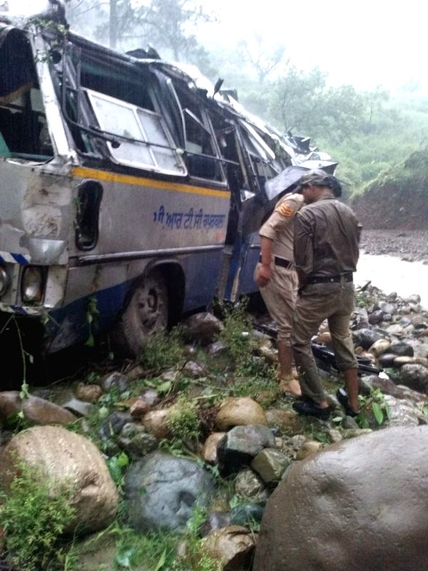 Mangled remains of a bus that fell in a gorge near Tumhari on Chamba Pathankot Highway in Himachal Pradesh on Aug 5, 2018.