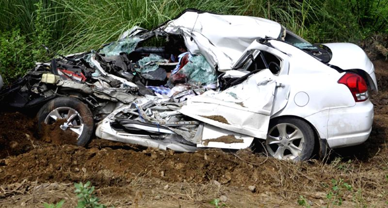 Mangled remains of a car which collided with a truck near Harikae in Tarn Taran district of Punjab on July 1, 2014. Four people were killed in the accident.