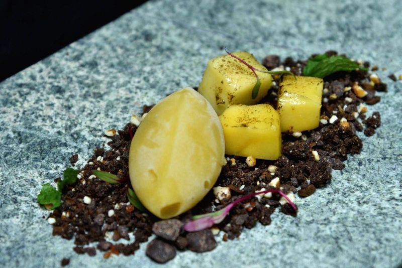 Mango, Cafe and Chocolate (Spiced mango sorbet served with syrup served with Coffee and Chocolate Soil).