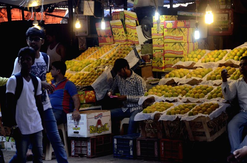 Mangoes for sale at a local market in Mumbai on April 29, 2014. The mangoes are in news as the European Union has temporarily banned the import of India's most expensive mango, the Alphonso, from ..