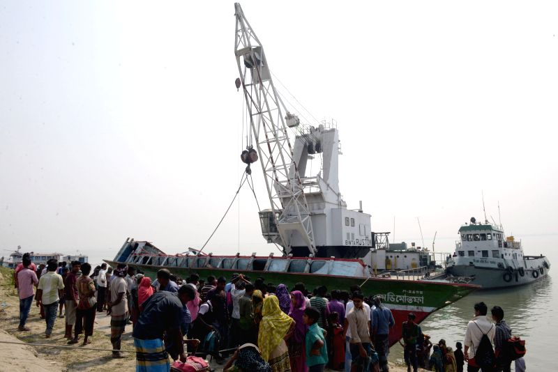 An ill-fated ferry is salvaged a day after it sank into the Padma River in Manikganj district, Bangladesh, Feb. 23, 2015. Death toll in Bangladesh's ferry ...