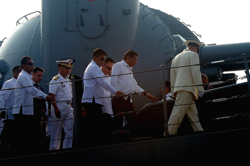 MANILA, April 21, 2017 - Philippine President Rodrigo Duterte (2nd R) tours the Russian missile cruiser Varyag at Pier 15 in Manila, the Philippines, April 21, 2017. The Russian missile cruiser is ...