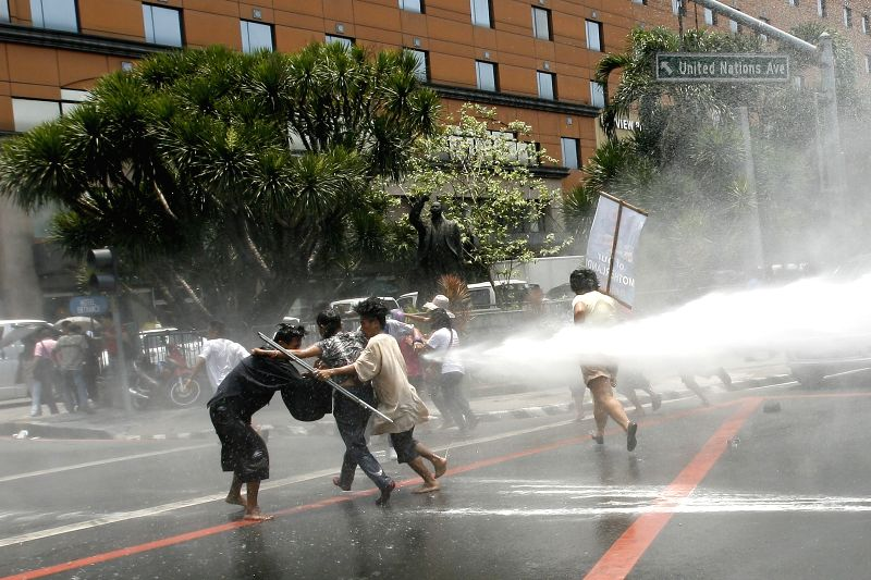 Activists are dispersed by water cannon during a protest rally near the U.S. Embassy in Manila, the Philippines, April 23, 2014. The protesters denounce the ...