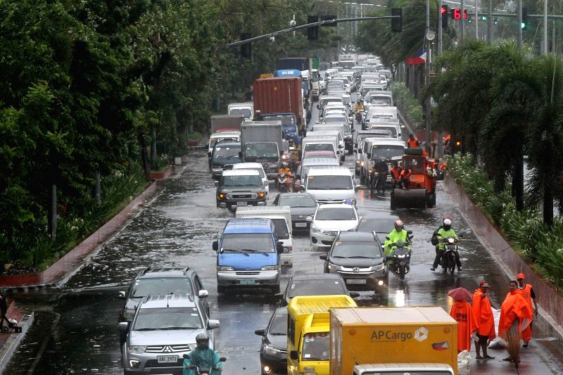 MANILA, Aug. 11, 2018 - Vehicles jam on a flooded road in Manila, the Philippines, Aug. 11, 2018. Typhoon Yagi brought gales and heavy rain in parts of Metro Manila.