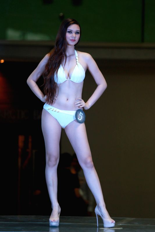 A contestant poses during the 2014 Miss Global Philippines presentation in Manila, the Philippines, Aug. 12, 2014. The winner of 2014 Miss Global Philippines pageant