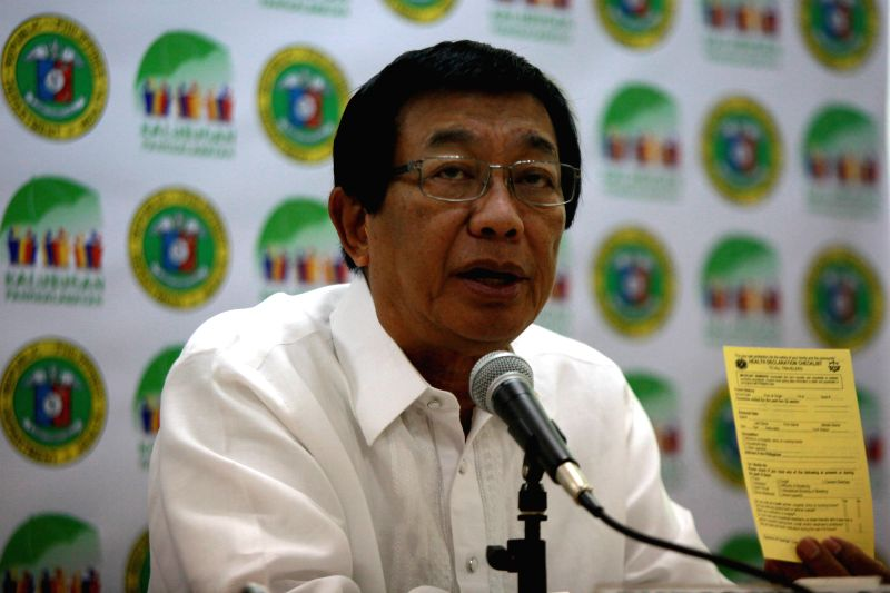 Philippine Department of Health (DOH) Secretary Enrique Ona speaks at a press conference on the Ebola Virus inside the DOH Headquarters in Manila, the Philippines, ...