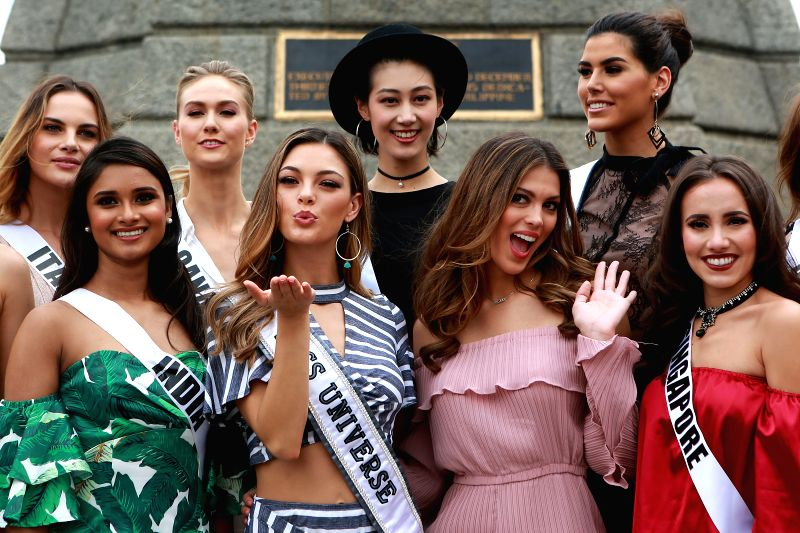 MANILA, Dec. 6, 2017 - Miss Universe 2017 Demi-Leigh Nel-Peters (2nd L F) of South Africa and Miss Universe 2016 Iris Mittinaere (2nd R F) of France smile as they visit the Rizal Park in Manila, the ...
