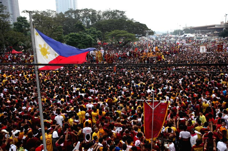 Devotees try to touch the life-size statue of the Black Nazarene during the annual feast of the Black Nazarene in Manila, the Philippines,  Jan. 9, 2015. The Black ...