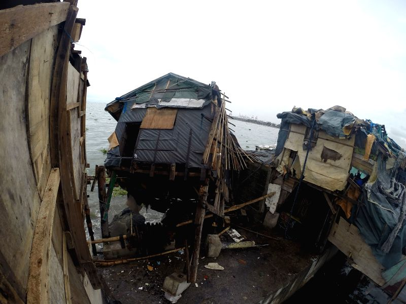 A shanty is toppled by typhoon Rammasun at a slum area in Manila, the Philippines, on July 17, 2014. The death toll from typhoon Rammasun rose to 38, the local ...