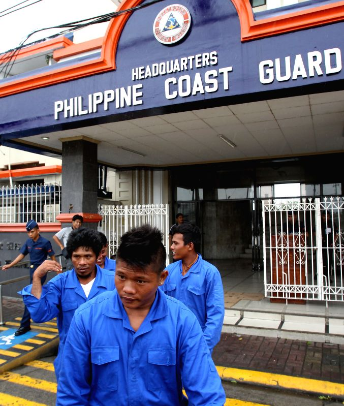Rescued Filipino fishermen exit the Philippine Coast Guard (PCG) Headquarters in Manila, the Philippines, on July 17, 2014. The crew of Chinese vessel MV Pacific ...