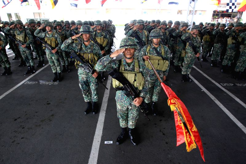 Members of the Marine Battalion Landing Team 5 (MBLT5) salute during arrival ceremony inside the Philippine Navy Headquarters in Manila, the Philippines, July 21, ...
