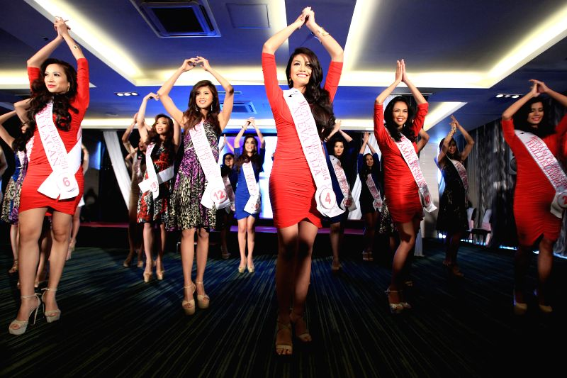Candidates dance during the press presentation for Mutya ng Pilipinas 2014 in Manila, the Philippines, July 23, 2014. 30 candidates from all over the Philippines ...