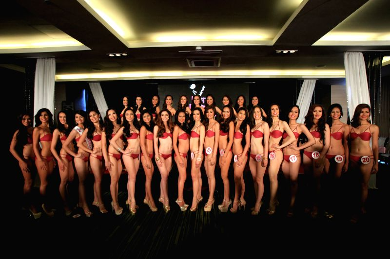 Candidates pose for photos during the press presentation for Mutya ng Pilipinas 2014 in Manila, the Philippines, July 23, 2014. 30 candidates from all over the ...