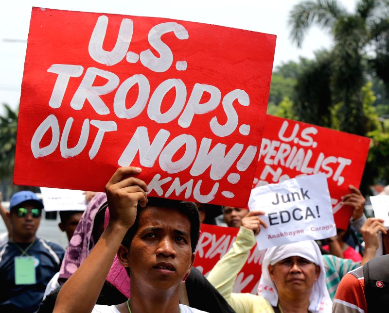 MANILA, July 27, 2016 - Activists hold placards during a protest rally near the U.S. Embassy in Manila, the Philippines, July 27, 2016. The activists are protesting against the visiting U.S. ...