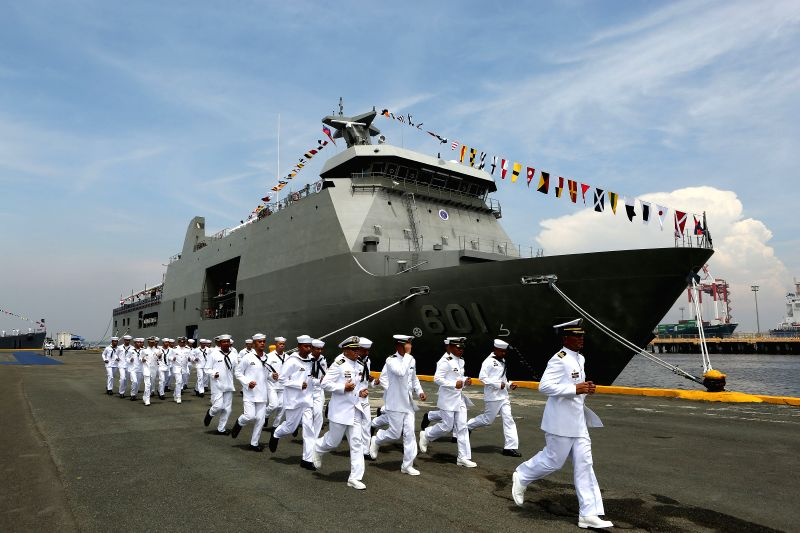 MANILA, June 1, 2016 - Members of the Philippine Navy march to their respective ships during the commissioning of new naval ships at Pier 13 in Manila, the Philippines, June 1, 2016. The Philippine ...