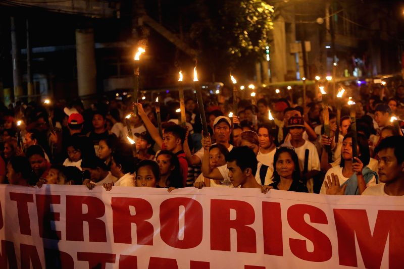 MANILA, June 12, 2017 - Activists hold placards during a protest rally in Manila, the Philippines, June 12, 2017. The protesters called for the end of terrorism in the country and the lifting of ...