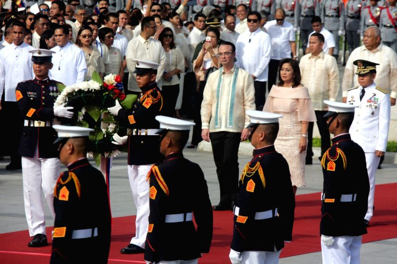 MANILA, June 12, 2017 - Philippine Vice President Leni Robredo, Foreign Secretary Alan Peter Cayetano, and Armed Forces of the Philippines Chief General Eduardo Ano participate in the celebration of ...