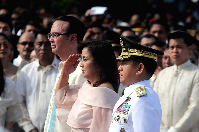 MANILA, June 12, 2017 - Philippine Vice President Leni Robredo (C), Foreign Secretary Alan Peter Cayetano (L), and Armed Forces of the Philippines Chief General Eduardo Ano, participate in the ...
