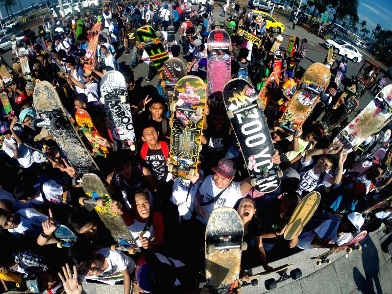 A skateboarder participates in a parade during the Go Skateboarding Day in Manila, Philippines, on June 21, 2014. Skateboarders around the world celebrate Go ...